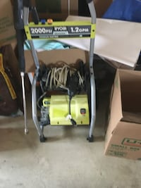 green and black Ryobi pressure washer