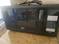 black and gray Oster microwave oven Silver Spring, 20906