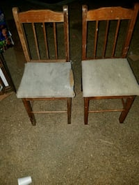 two brown wooden framed white padded chairs Magee