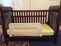 baby's brown wooden crib Woodbridge, 22193