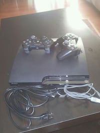 Sony PS3 slim console with two controllers Kitchener, N2M 4B5