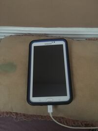 White samsung android smartphone with blue case Pascagoula