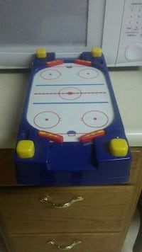 blue and white air hockey table