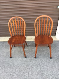 two brown wooden windsor chairs 581 mi