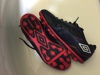 pair of black/red Umbro soccer shoes