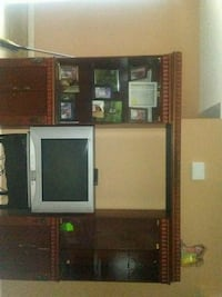 brown wooden TV hutch with flat screen television Stockbridge, 30281