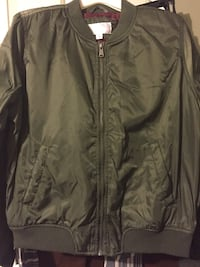Olive green jacket only $8 look at price tag $39.99 Clarksville, 37042
