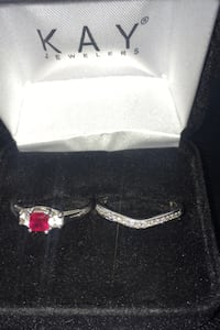 Woman's white gold ruby ring with diamond band Point of Rocks