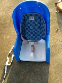 baby's blue and White portable high chair with bel Garland