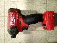 red and black Milwaukee cordless impact wrench 42 km