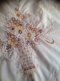 "Embroidered oval tablecloth, vintage excellent condition, 67""x84"" in cream color . Brossard, J4Y 2Z6"