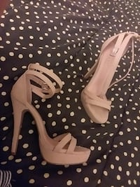 pair of white leather open-toe ankle-strap platform pumps