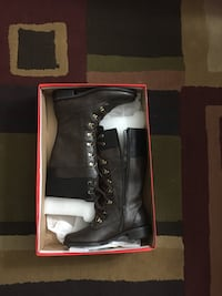 pair of women's black leather mid-calf side-zip boots with box