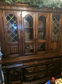Real Wooden table and chairs with a hutch, hutch has lighting Stockton