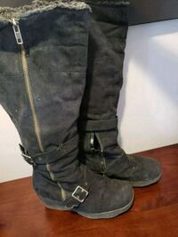 pair of black leather knee-high boots Calgary, T2W 1C8