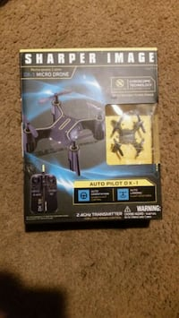 black and yellow quadcopter drone in box