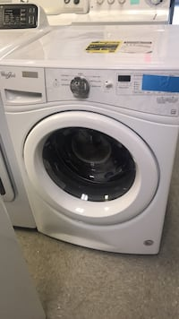 white front-load clothes washer Ranson, 25438