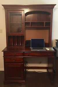 Solid wood desk and lighted hutch from Haverty's. Paid $1500 new. Tyler, 75701