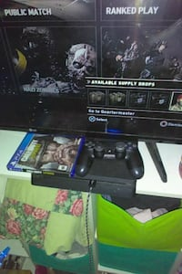 black Sony PS4 console with controller and game ca Sherman, 75092