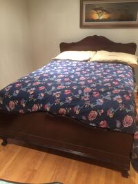 brown wooden bed frame, white, purple, and blue floral bed comforter Toronto, M9L 2L2