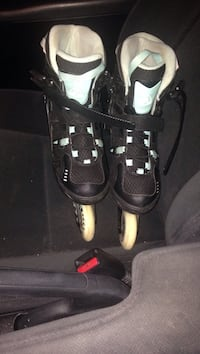 Pair of teal and black rollerblades size 8.5 Central Okanagan, V1Z 3P6