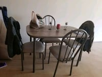 round brown wooden table with four chairs dining s Norfolk, 23508