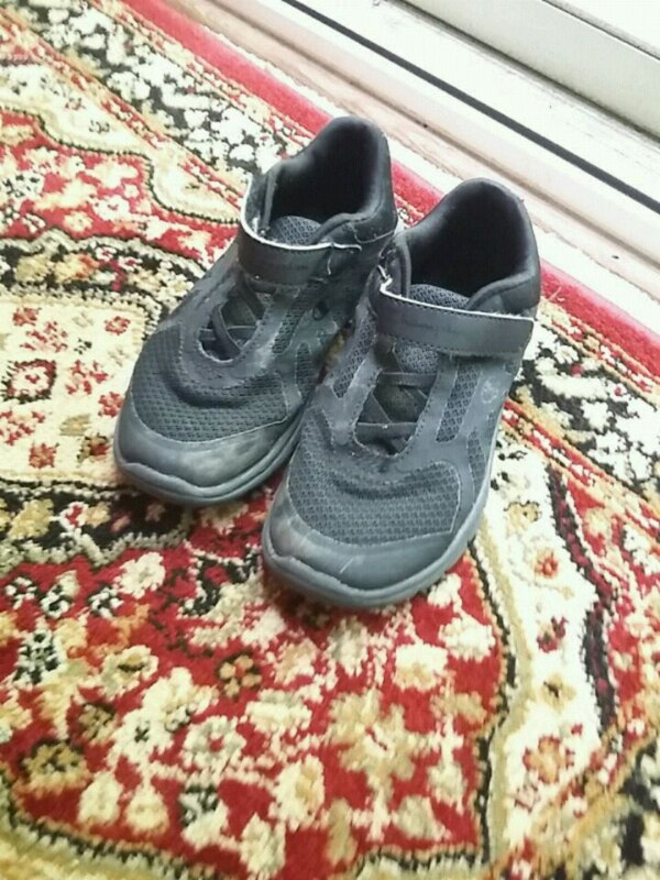 pair of black-and-gray running shoes