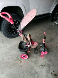 toddler's pink and black trike Division No. 6, T2X