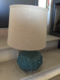 Adorable teal lamp with tan shade used in staging