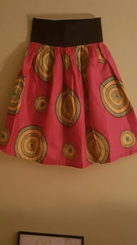 African print mini skirt.  Fits size 2 to 4