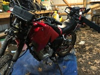125 enduro dirt bike it's a china clone bike the lights and stuff don't work but she runs and rides the front tire is flat 400 obo Midland, 22728