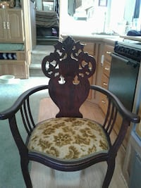 brown wooden padded floral armchair