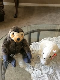 two brown and white dog plush toys Calgary, T2Y 4E4