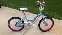 blue and white bicycle with training wheels