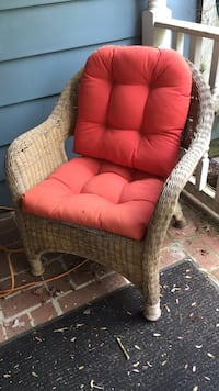 Wicker chair with orange cushion   In good condition. $15 or best offer Alexandria, 22315