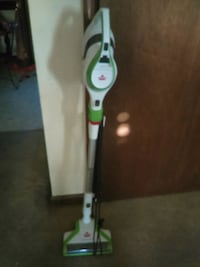 green and white upright vacuum cleaner 586 mi