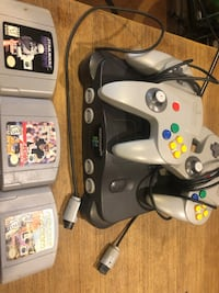 Nintendo 64- 3 games- two controllers-  No power cord Surrey, V3Z 0J7