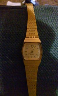 square gold analog watch with gold link bracelet Coos Bay, 97420