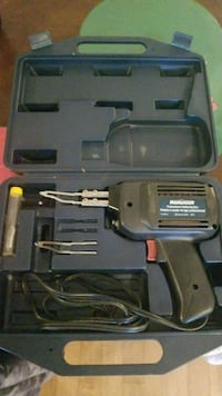black and gray corded power tool with case Gatineau, J8T 3M1