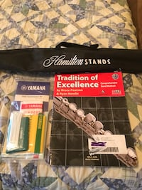 Flute music book and cleaning kit. Along with stand .