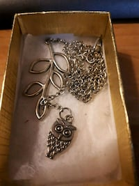 Owl and leaf necklace .