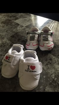 toddler's pair of white Nike shoes