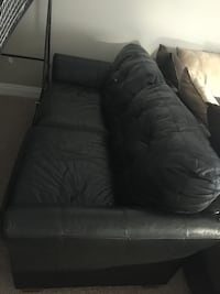 Black leather tufted sofa chair Kitchener