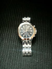 round silver chronograph watch with link bracelet