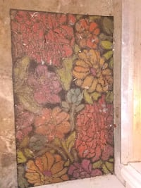 brown and green floral area rug