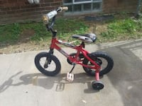 toddler's red and black bicycle with training wheels Redford Charter Township, 48239