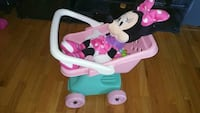 Minnie Mouse plush toy with pink and green plastic stroller