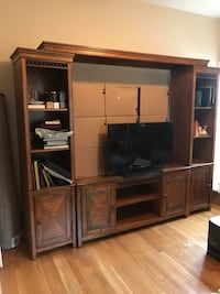 brown wooden TV hutch and flat screen TV 14 mi