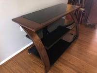 LIKE-NEW CHIC TV STAND - CHESTNUT BROWN WITH BLACK GLASS DETAIL Gaithersburg, 20878