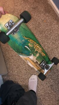green and brown skateboard deck 170 mi
